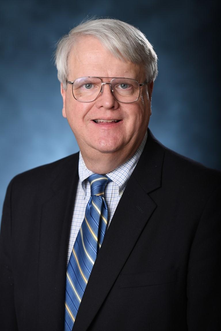 Dr. William R. Rhodes